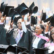 Is Zimbabwe's adult literacy rate the highest in Africa?
